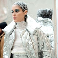 Italian designer Laura Strambi. Silver quilted down jacket made in Newlife(TM) recycled polyester jersey white turtleneck top made in organic cotton. http://ift.tt/2vDZwUs  Photo by Anna Minaeva/Croccolo #fashion #sustainability #sustainablefashion #recycled #organiccotton #italianfashion #italianstyle #polyester #recyckledpolyester #recycling