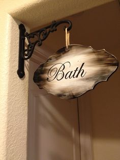 DIY bathroom sign with simple wooden plaque and shelf bracket
