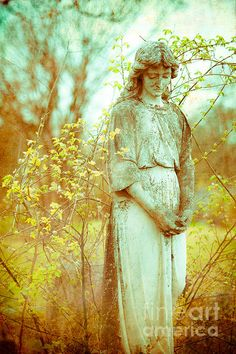 Solemn statue in historical Dallas cemetery. Photograph by Squint Photography