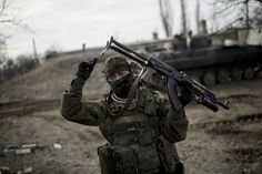 Ukrainian regular soldier on the front line with AK47 and BG15.