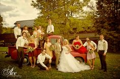 Photo of the wedding party with that old truck at the Atkinson-Smith House (: