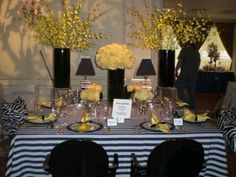 Striped linen with  black and yellow tablescape.