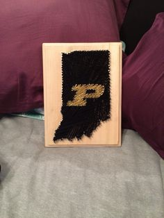 I made this string art for my boyfriend's birthday! First, I nailed the outline of Indiana and the Purdue logo. next, I used old gold strong for the Purdue 'P' and then continuously strung black string to fill out the rest of the state. It ended up taking over 2 hours by the time I covered every part of the state. ( it would have been easier to paint in the state and use less string) He absolutely loved it!!