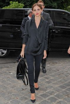 Emma Watson attends Giambattista Valli Fashion Show. I wish I looked this good in slouchy tops.