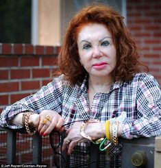 Jackie Stallone.  At 91, NOT growing old with dignity. She looks like a burns victim.