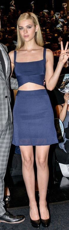Who made Nicola Peltz's cropped top, blue skirt, and black platform pumps that she wore in Tokyo on July 28, 2014