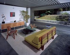 Warm Modern Interiors by Kenneth Brown Design [I have to say that I am in love with this midcentury modern meets industrial (floor and ceiling)! I am IN LOVE with those case study daybeds (though the wire famed ones)! The fabric on that one is particularly beautiful and rich and luxurious.]