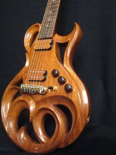 This has to effect sound, Right?  Rigaud Guitars Blog: More of the Beautiful Phoenix Hand Carved Electric Guitar By Rigaud Guitars