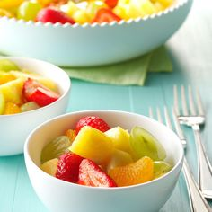 Sparkling Fruit Salad Recipe -Pineapple chunks, mandarin oranges, strawberries and grapes are treated to a dressing of wine and sparkling club soda in this delightful salad. Serve in dessert dishes or set the whole bowl on the table for a fetching presentation.