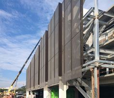 Construction photo of the perforated metal panel screen system at Stanford University Parking Garage