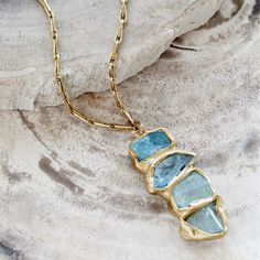 Emilie Shapiro's jewelry collection features generous hunks of lovely yet rough-hewn aquamarine.