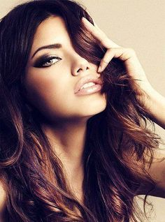 This gals got a beautiful face, but also beautiful makeup. Maybe for a fancy night out. nude lip, dark cat eye, defined brow
