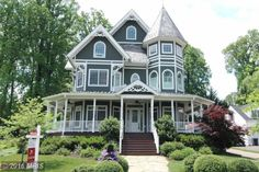 For sale: $1,580,000. Victorian Home* 4 Levels 6 BR/5BA * All Upgraded Baths w/ rain shower heads, dual sprays & claw-foot tub * Complete 360 Wrap-Around Porch w/ceiling fans * Rosewood Flooring & Slate Roof * Crown Molding & Custom Built-Ins *Main Level BR suite* Granite Countertops & SS Appliances *Pella windows & Solid 10 ft doors *Energy efficient Radiant Floor Heating!