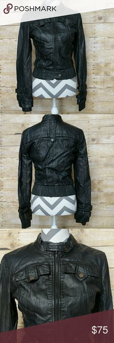 bebe Black Faux Leather Jacket Sexy Bebe black leather jacket. Lots of detail as shown with buttons and buckles. Like new condition. No stains or tears. bebe Jackets & Coats