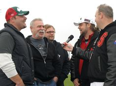 Paul Teutal Jnr, Paul Teutal Snr and Mikey Teutal form 'American Chopper' with Russell Crowe in Jacksonville, USA.