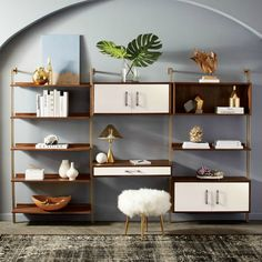 walnut and brass wall-mounted shelves