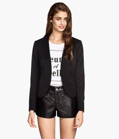 Black faux leather shorts with high waist and decorative zippers. | H&M Divided