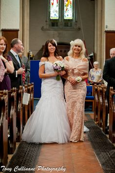 Bride and her mother walk up the aisle