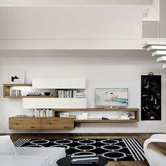 Die Moderne Kombination Aus Offenen Geschlossenen Und Unterschiedlichen  Tiefen Elementen Macht Den Charme Der Livitalia Wohnwand