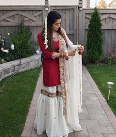 Off white gharara and red shirt Eid Dresses, Pakistani Wedding Dresses, Indian Wedding Outfits, Pakistani Outfits, Indian Outfits, Pakistani Clothing, Pakistani Bridal Wear, Gharara Designs, Lehenga Designs