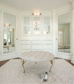 Too gorgeous | Place an ottoman in the center of a walk-in closet and conceal storage behind wall mirrors - Smart and Pretty