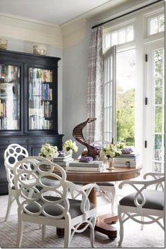 Alexa Hampton.  The chairs are original loop chairs by Francis Elkins.