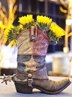 Western theme boot centerpiece idea. Already have the boot just need the flowers! :)