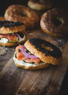 bagels with lox, cream cheese, capers, red onion & pickles