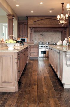 Species: Villa™ Collection, Vintage French Oak hardwood floor, smooth face, hand V-groove beveled, hand distressed (Signature) ~ 30 Stunning Kitchen flooring Designs - Style Estate - Classic Kitchen, New Kitchen, Kitchen Decor, Kitchen Wood, Kitchen Ideas, Kitchen Cabinets, Kitchen White, Dark Cabinets, Kitchen Bars