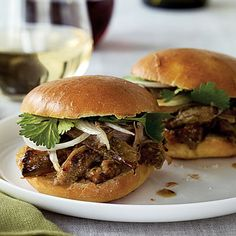 Island-style Pulled Pork Sandwiches  Pork shoulder has the double advantage of pairing well with both white and red wines, and being one of the cheaper cuts at the meat counter. Long-braised and roasted, it also delivers a huge amount of flavor. Serve these sandwiches with fresh cilantro sprigs and thinly sliced sweet onions (such as Maui) for each person to add to taste.