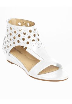 These smooth leather-like womens sandals feature a chic laser cut design that is instantly trendy when paired with any casual outfit.  back counter zipper closure new sock lining is designed with high-density memory foam and extra heel cushioning for lasting support and comfort flexible, skid-resistant soles are designed for better traction our extended sizes provide a perfect width in medium, wide and wide wide stabilized heel design and sound construction offer better support 1 1/2&#...