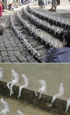 Art installation with hundreds of little frozen men, left out to melt in the heat of the sun