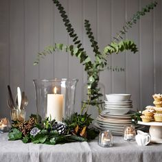 How to make a wire coat hanger centrepiece. These simple wreaths will make a great indoor and outdoor festive decoration. Visit www.redonline.co.uk for a step-by-step guide.