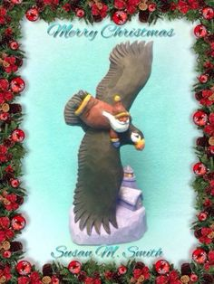 Hand-carved-Santa-on-flying-Puffin-lighthouse-by-Susan-M-Smith