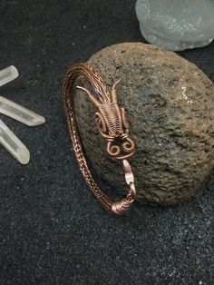 Hand woven dragon head with viking knit bracelet. I handmade the beautifully detailed dragon head with 18 and 28 gauge bare copper wire , the eyes are 4 mm solid copper round beads . The body of the beast is made of 24 gauge bare copper wire woven into a double viking knit