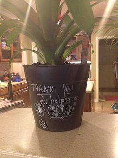 Teacher Appreciation gift.  Black planter from Walmart with white paint pen.  Looks like chalk on black board.