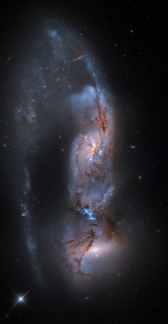HST image of interacting spiral galaxies NGC 6621 and 6622, also known as Arp 81; post-processing by Martin Pugh to bring out greater detail