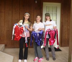 Sarah Finnegan, Madison Desch and Brenna Dowell with their National Team leos.