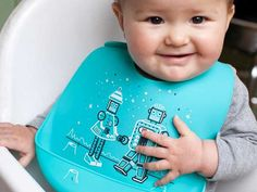 """""""A flexible, wipeable bib with a handy pocket to catch escaped food."""" - Read @Babyology's review of our BucketBib!"""