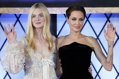Elle Fanning and Angelina Jolie wave to the crowds at the Tokyo premiere of Maleficent.