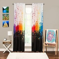 Amplify the look of your bedroom with the vivacious and vibrant Crayola Cosmic Burst 84-Inch Rod Pocket Window Curtain Panel. The eye-catching panel is splattered with vivid bursting colors over a black and white background.
