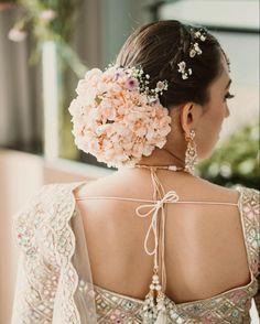 Hair: Shradha Luthra   Fresh flowers in pastel hues for bridal bun   Indian bridal hairstyle inspiration   #wittyvows #bridalhair #bridalhairstyles #flowers #hairdo #bridalinspiration #weddinginspiration #indianwedding #bride #bridetobe #fashion Indian Wedding Hairstyles, Bride Hairstyles, Rose Bun, Bun With Curls, Bridal Bun, Hair To One Side, Bridal Hair Inspiration, Lilac Wedding, Sleek Hairstyles