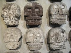 Stone skulls from the Templo Mayor in the Aztec capital of Tenochtitlan. They represent the tzompantli or skull racks where the heads of sacrificial victims were placed.