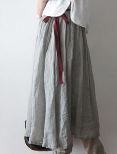 put a cute belt/sash with the gauze skirts - or dresses with tops over them