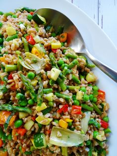 Here's a loaded salad that's filled with roasted veggies and delicious chewy farro, this is not a wimpy salad by any means! This loaded farro salad is filled with veggie goodness featuring, asparagus, zucchini, yellow squash, peas, red, yellow and orange peppers, artichoke hearts, green onions, basil and parsley then tossed in a bright lemon …