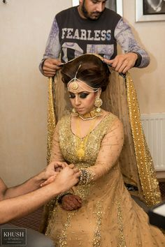 Asian bride getting ready. www.khushstudio.co.uk Asian wedding photography and cinematography.