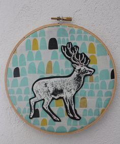 Add instant style to your little one's room (or your own) with this unique and original embroidery hoop art. This super cool deer has been stamped on canvas, cut and stitched onto a beautiful piece of sea foam green, black and gold organic cotton. It is featured in a 6 inch hoop.  It is sure to add a pop of colour and a dash of fun wherever you choose to display it.  It looks great on it's own or hung with others.  This is a fantastic gift for a new baby or child!  Please visit my shop to…