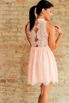 Not just another lace dress, the Bellini Dress features a stunning open sheer lace back with button detail. The dreamy floral lace is done in a blushing peach which can easily take you into your Fall