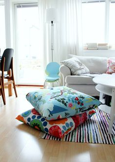 Floor pillows - I use to work for an after-school program and at the church, there was a movie room with tons of large pillows. The Kids loved playing in that room - it was just a room full of pillows. The room had a cozy feel to it & it makes for great seating if necessary.