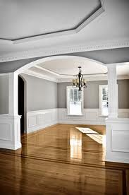 millwork - darker floors with a square column. Love the gray and white with black accents